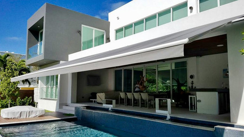 Retractable Awnings | Buzzman Awnings Inc