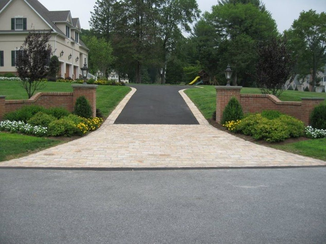 $100 off Driveway or Patio Sealing